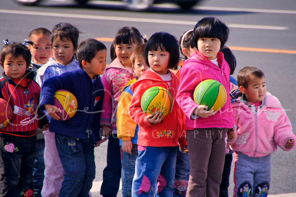 CHINA: Beijing kids with balls.
