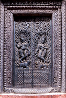 Decorated wooden door to the temple.