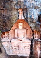 Sitting Jain figures carved out of Gwalior's Rock.