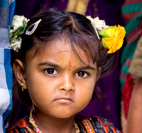 Young girl with stern face.