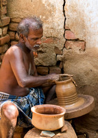 The shaping of an earthen pot.