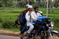 Three young muslims on a motorbike.