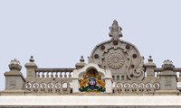 Coat of arms of Karnataka on top of Parliament building.